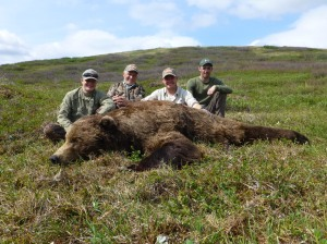Cody, hunters and bear